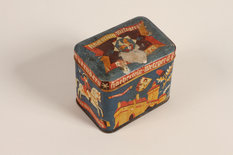 2004.485.49_a-b front Haeberlein-Metzger lebkuchen blue decorative tin brought to the US by a German Jewish refugee