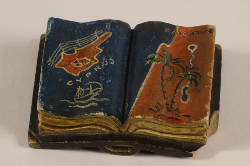 2003.465.2 front Carved stone book with a painted map of Cyprus and Palestine acquired by a British officer