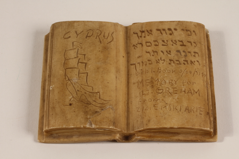 2003.465.3 front Carved stone book with an inscription made for a British officer by a Jewish internee in Cyprus