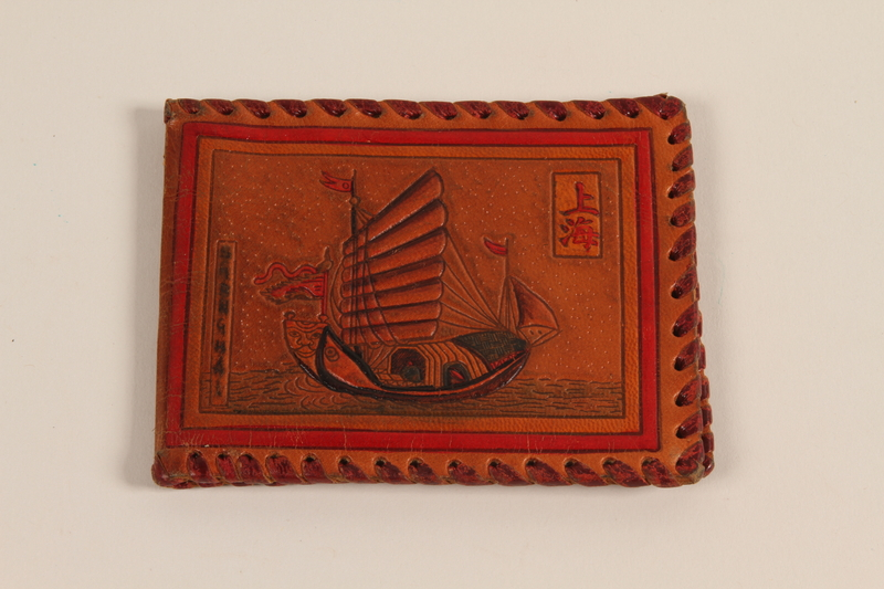 2004.524.2 front Laced leather billfold with a painted harbor owned by a German Jewish refugee