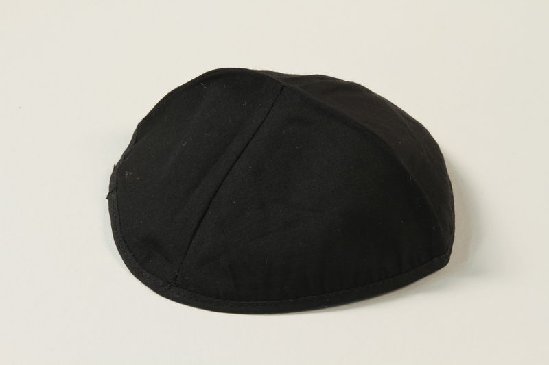 2004.524.6 front Black yarmulke used by a German Jewish refugee