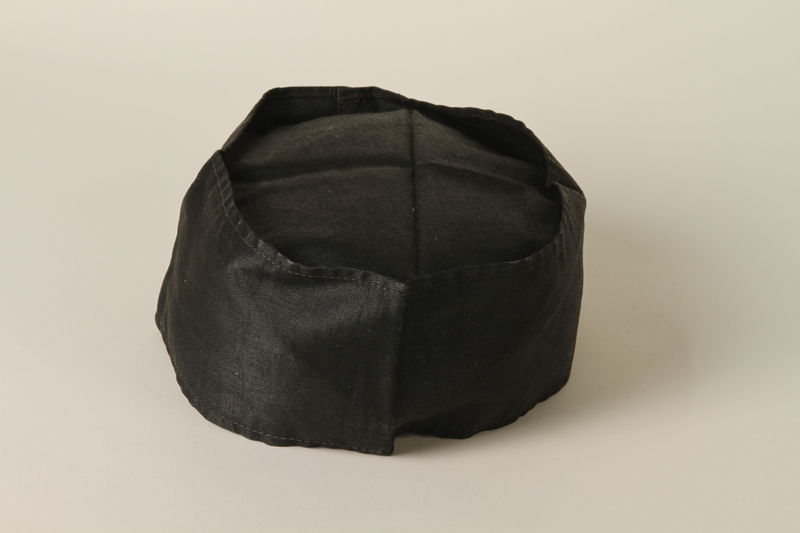 2004.524.12 front Black cloth cap owned by a German Jewish refugee