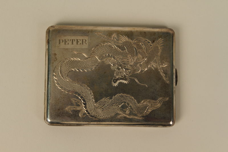 2004.524.18_a front Engraved silver cigarette case with box owned by a German Jewish refugee
