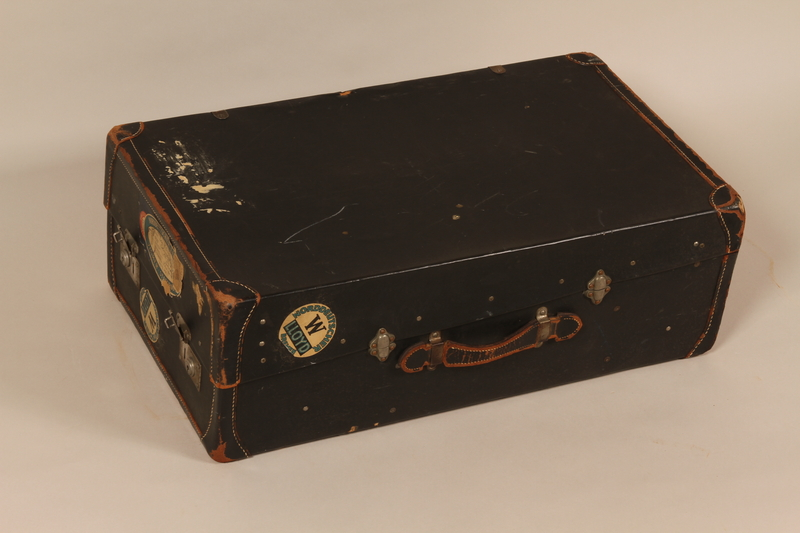 2004.526.2 front Black flat top steamer trunk used by a Jewish Austrian refugee