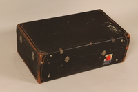 2004.526.2 back Black flat top steamer trunk used by a Jewish Austrian refugee  Click to enlarge