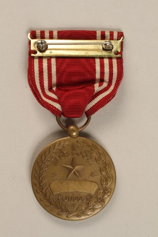 1998.126.1 back Military badge