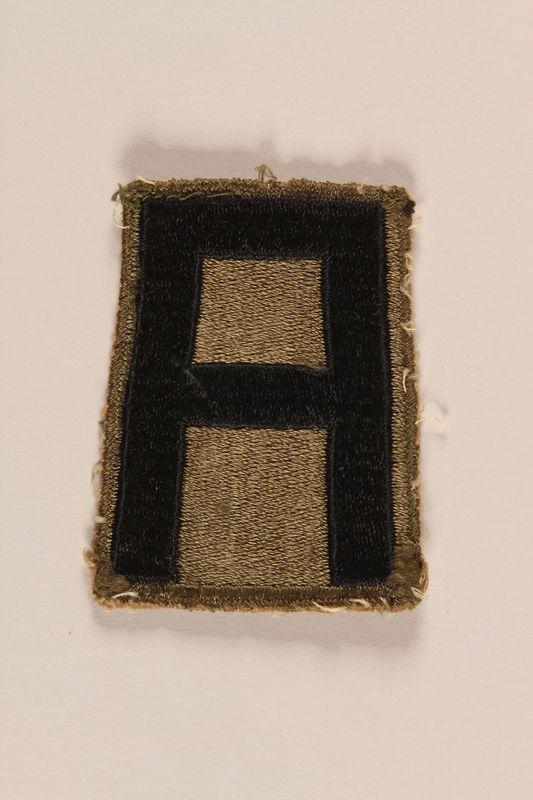 1998.126.16 front Shoulder badge