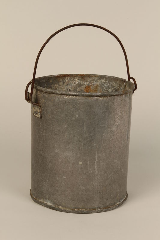 1998.132.1 front Tin pail made for one prisoner by another in Kaufering concentration camp