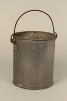 1998.132.1 front Tin pail made for one prisoner by another in Kaufering concentration camp  Click to enlarge