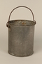 Tin pail made for one prisoner by another in Kaufering concentration camp