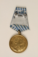 1999.179.2 back Medal for bravery awarded by the Yugoslav Liberation Army  Click to enlarge