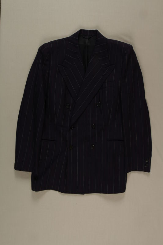 2004.680.1_a front Navy blue pinstriped jacket and pants worn by the groom at his wedding to another survivor in a DP camp