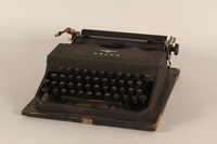 1999.174.1_a front Adler typewriter with fitted case used by a Jewish family in a displaced persons camp  Click to enlarge