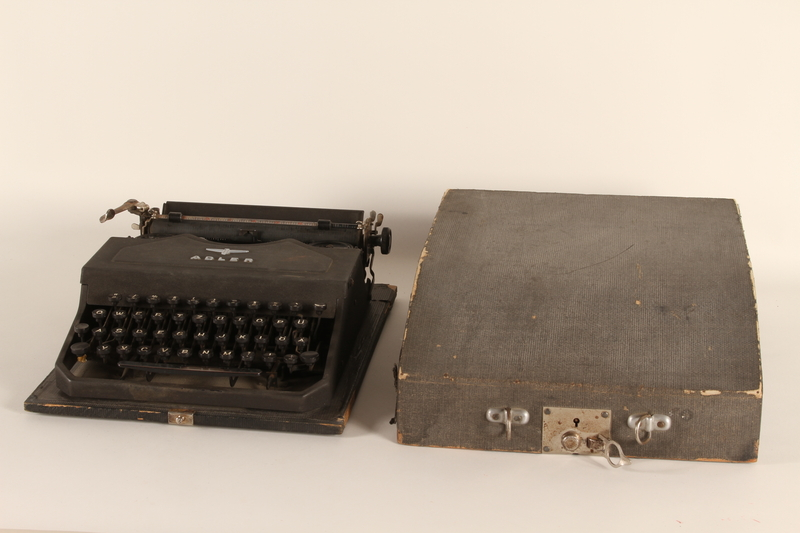 1999.174.1_a-b front Adler typewriter with fitted case used by a Jewish family in a displaced persons camp