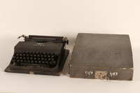 1999.174.1_a-b front Adler typewriter with fitted case used by a Jewish family in a displaced persons camp  Click to enlarge