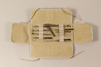 1999.91.2.1-.9 open Canvas medical case with with 27 instruments  Click to enlarge