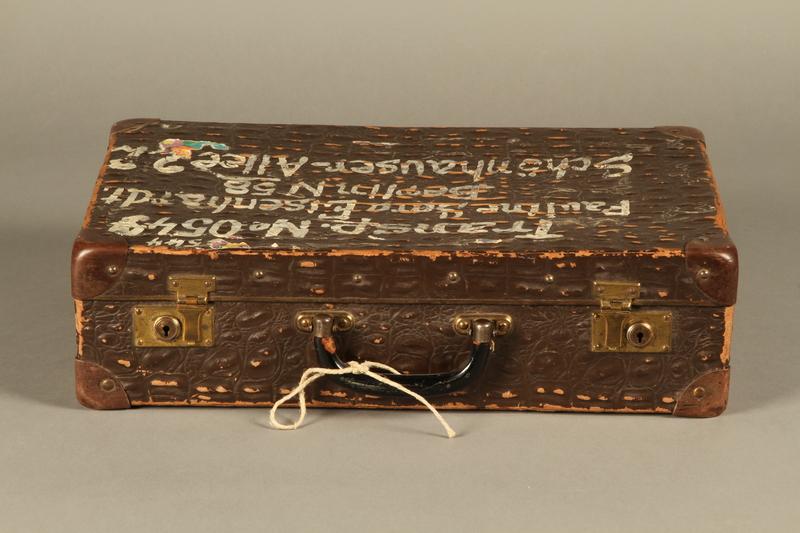 2005.89.1 front Faux alligator suitcase issued to inmates released in Bergen-Belsen prisoner exchange