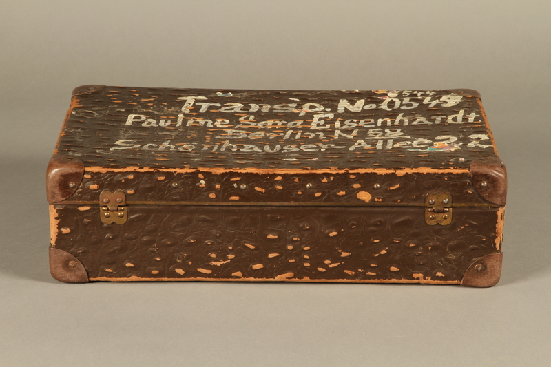 2005.89.1 back Faux alligator suitcase issued to inmates released in Bergen-Belsen prisoner exchange