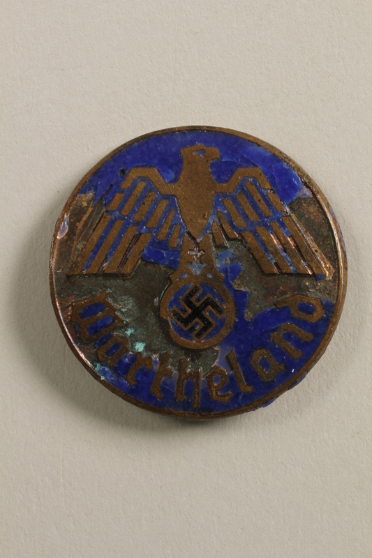 2000.219.12 front Blue painted Nazi Wartheland badge with eagle