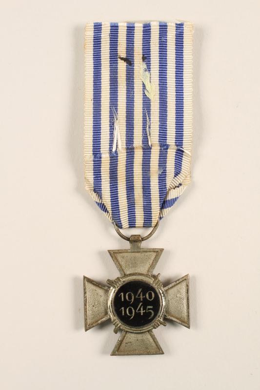 2005.25.4 back Croix du Prisonnier Politique de la Guerre 1940-1945 medal with ribbon, 2 stars, awarded to a Belgian resistance fighter