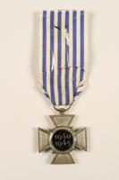 2005.25.4 back Croix du Prisonnier Politique de la Guerre 1940-1945 medal with ribbon, 2 stars, awarded to a Belgian resistance fighter  Click to enlarge