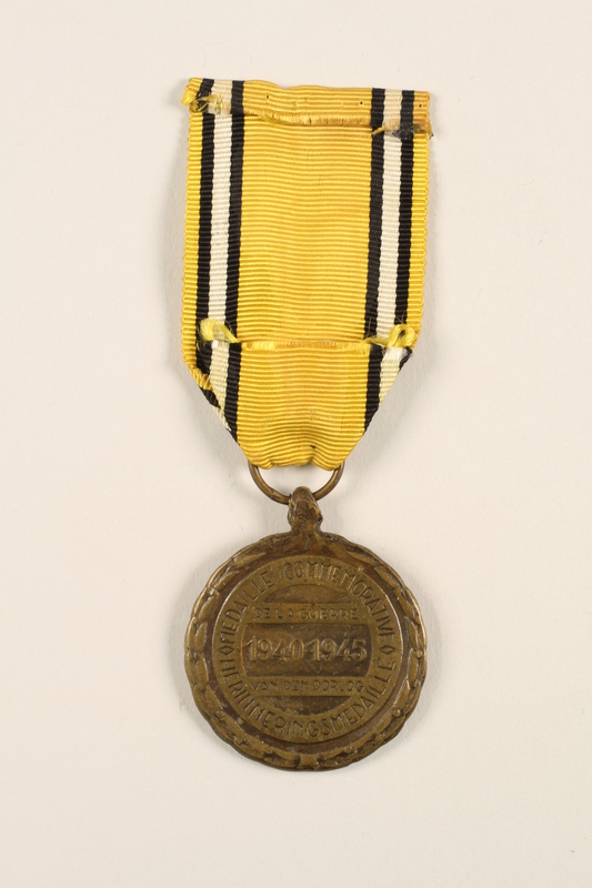 2005.25.6 back Commemorative Medal of the War 1940-1945 medal and ribbon awarded to a Belgian resistance fighter