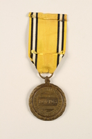 2005.25.6 back Commemorative Medal of the War 1940-1945 medal and ribbon awarded to a Belgian resistance fighter  Click to enlarge
