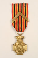 2005.25.8 front Military Decoration for Loyalty medal, ribbon, and chevron awarded to a Belgian resistance fighter  Click to enlarge