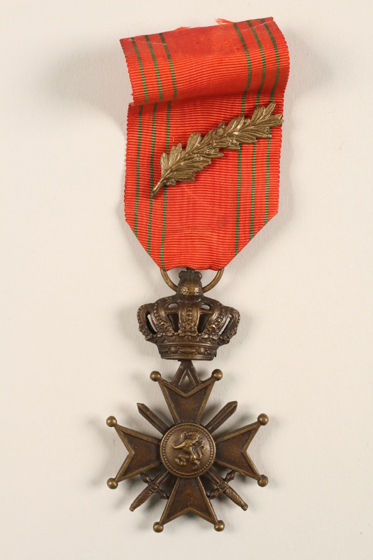 2005.25.9 front King Leopold III Croix de Guerre 1940-1945 medal, ribbon, and gold palm citation awarded to a Belgian resistance fighter