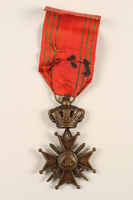 2005.25.9 back King Leopold III Croix de Guerre 1940-1945 medal, ribbon, and gold palm citation awarded to a Belgian resistance fighter  Click to enlarge