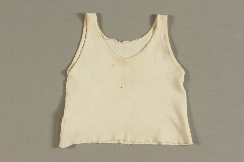1998.41.3 front Toddler's white knit undershirt worn by a Jewish refugee from German occupied France
