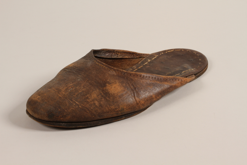 2004.702.2 a front Pair of leather slippers received from Oskar Schindler by a Jewish Polish worker