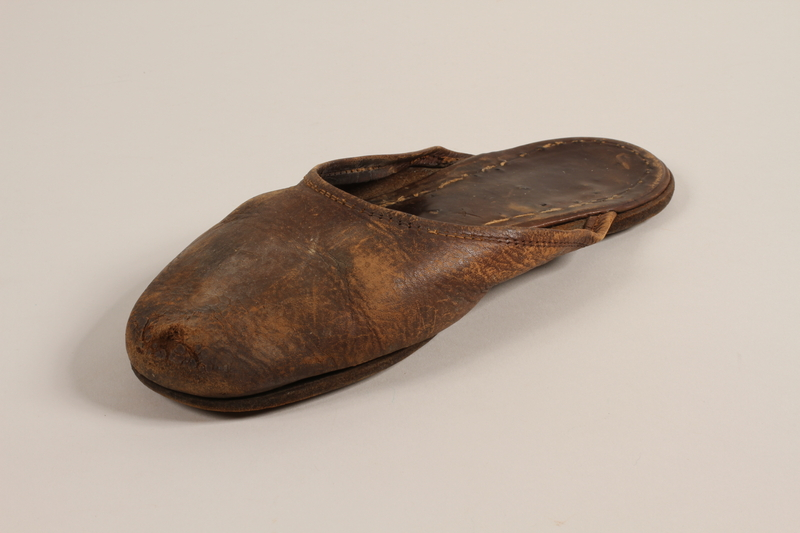 2004.702.2 b front Pair of leather slippers received from Oskar Schindler by a Jewish Polish worker
