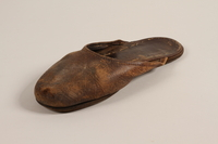 2004.702.2 b front Pair of leather slippers received from Oskar Schindler by a Jewish Polish worker  Click to enlarge