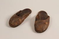 2004.702.2 a-b front Pair of leather slippers received from Oskar Schindler by a Jewish Polish worker  Click to enlarge