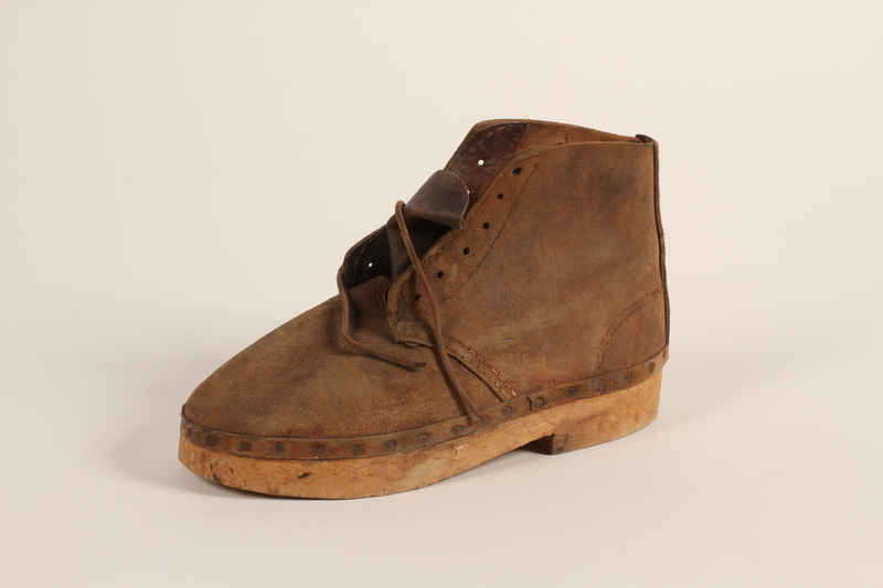 2004.705.3_a front Pair of handmade wooden soled suede boots from Mauthausen concentration camp