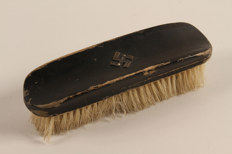 2004.705.9 front Hairbrush with a metal swastika