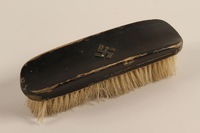 2004.705.9 front Hairbrush with a metal swastika  Click to enlarge