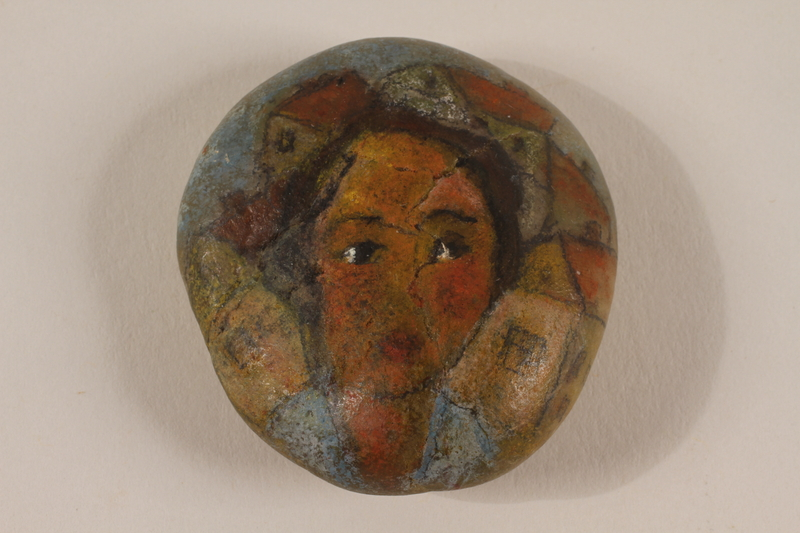 2004.705.11 front Stone with a painted portrait of a young girl with short hair who was killed in a concentration camp