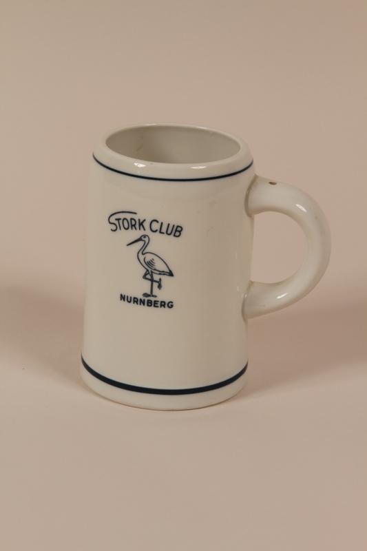 2004.705.12 front International Military Tribunal Stork Club white porcelain mug