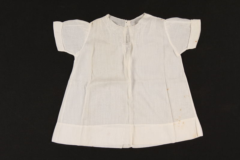 2000.617.9 front Short sleeved white embroidered infant's dress