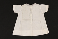 2000.617.9 front Short sleeved white embroidered infant's dress  Click to enlarge
