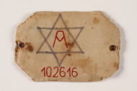 2004.706.3 front Arbeitsjude [Jewish worker] armband number 102616 worn in the Boryslaw ghetto  Click to enlarge