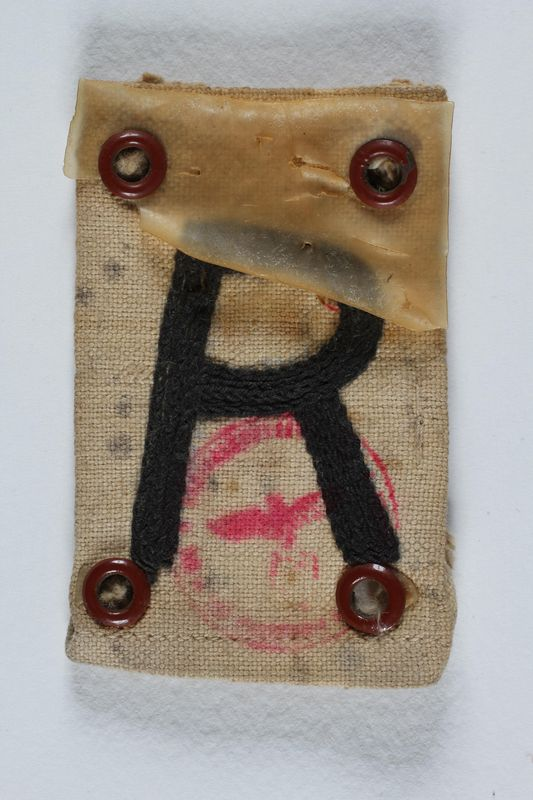 2004.706.6 front Badge with an R for Rustung (Armament) worn by a Polish Jewish worker in Beskiden labor camp
