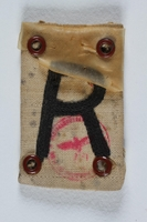 2004.706.6 front Badge with an R for Rustung (Armament) worn by a Polish Jewish worker in Beskiden labor camp  Click to enlarge