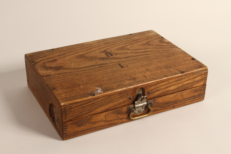 2004.706.8 closed Wooden box with inlaid initials used by a Polish Jew in hiding in the Boryslaw ghetto