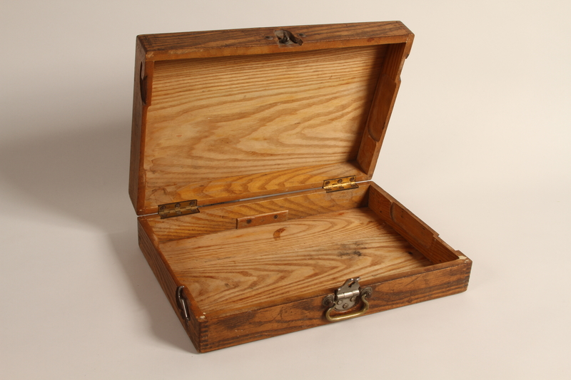 2004.706.8 open Wooden box with inlaid initials used by a Polish Jew in hiding in the Boryslaw ghetto