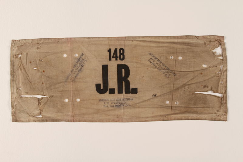 2004.707.2 front Joodsche Raad armband worn by a German Jewish aide in a transit camp