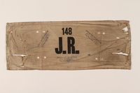 2004.707.2 front Joodsche Raad armband worn by a German Jewish aide in a transit camp  Click to enlarge