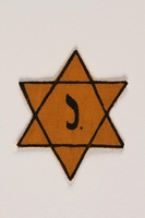 2003.318.3 front Star of David badge with letter J owned by Jewish Belgian couple  Click to enlarge